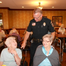 National Night Out-Arbor Lakes Senior Living-visiting with the Maple Grove police