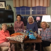 Dialysis Arm Pillows-Arbor Lakes Senior Living-group shot of the workers