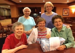 Domino Fun-Arbor Lakes Senior Living-tenants playing Mexican train dominoes